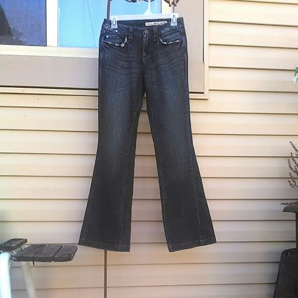 """Dark Wash DKNY Jeans 99% cotton, 2% spandex flares. Distressed, pocket detailing front & back. Measured flat 30"""" inseam 13"""" across waist band. DKNY Jeans Flare & Wide Leg"""