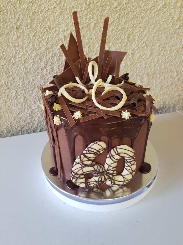Chocolate Drip Cake Loaded With Tempered Chocolate Decorations For