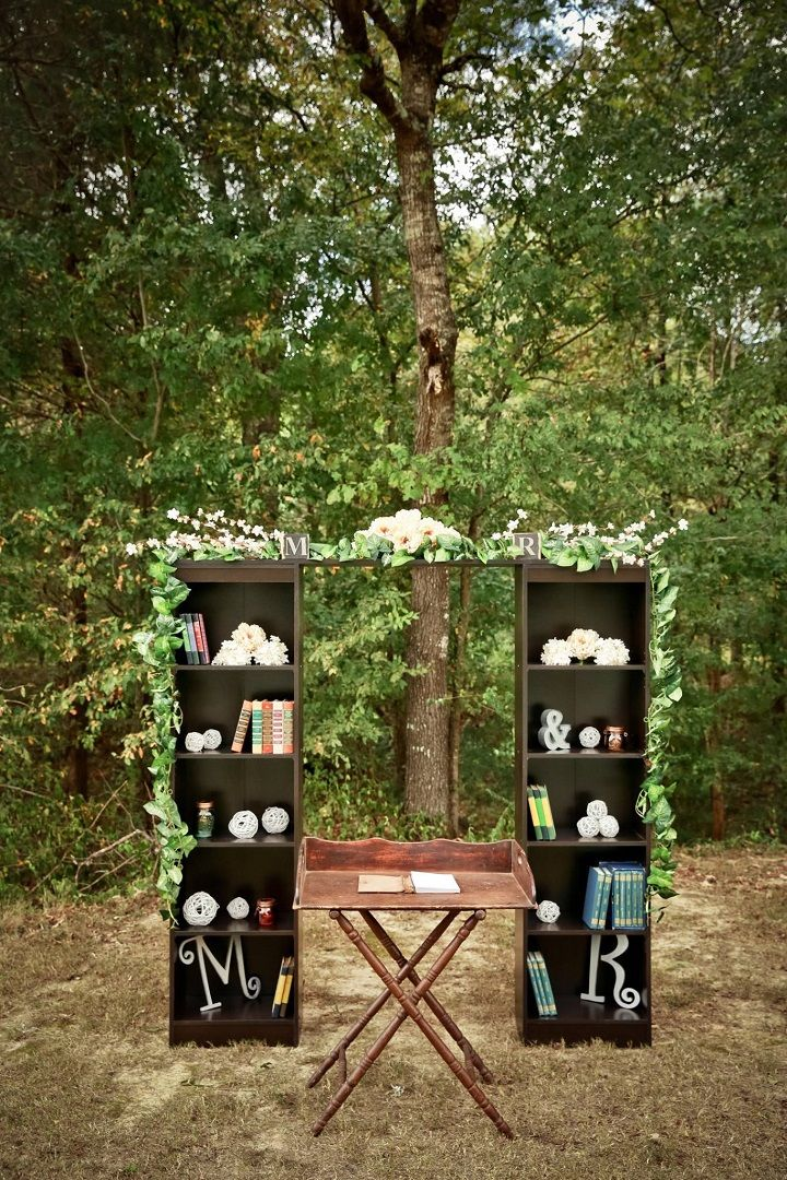An arch for the wedding ceremony used of the old bookshelves | Navy Blue and Gray Rustic Literary-themed Wedding with DIY details | fabmood.com #navyblue #navybluewedding #vintagestyle #weddingceremony #literarywedding