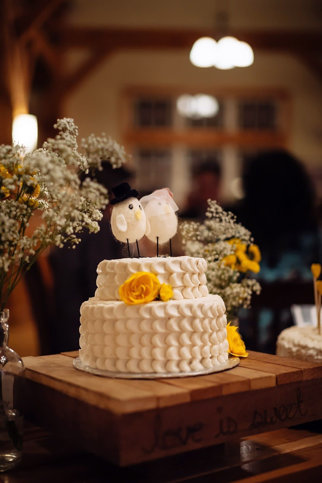 Rustic wedding cake with buttercream icing artificial yellow