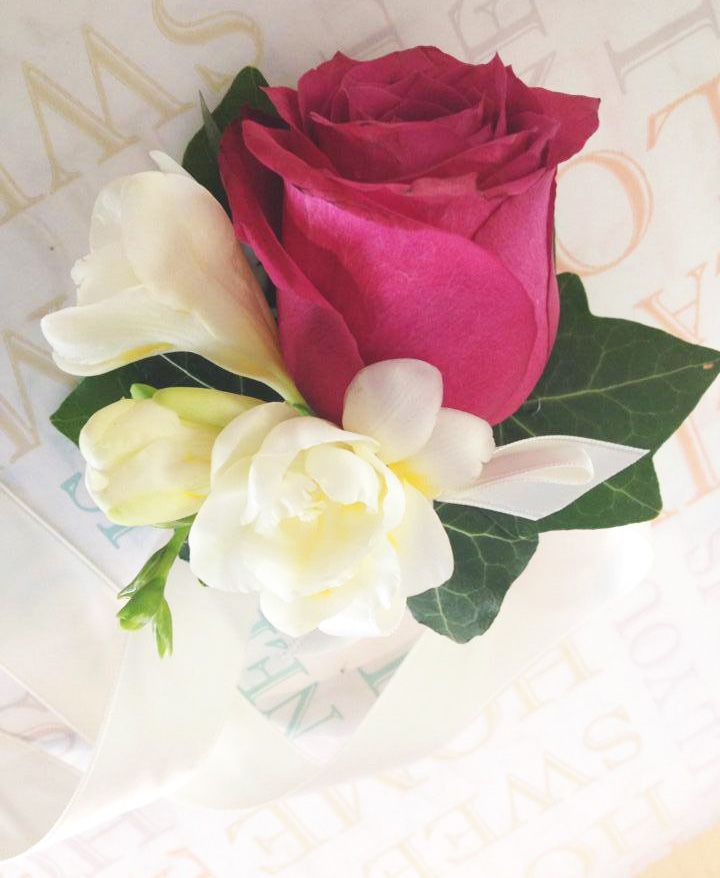 Classy pink rose and freesia wrist corsage with ivory satin ribbon