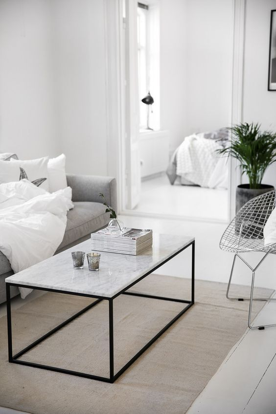 Marble table in white and grey in a modern livingroom Minimal