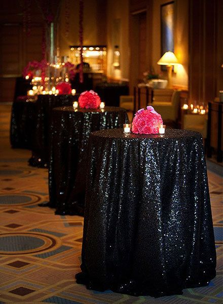 Black Sequined Tablecloth And Red Kissing Ball Centerpiece.