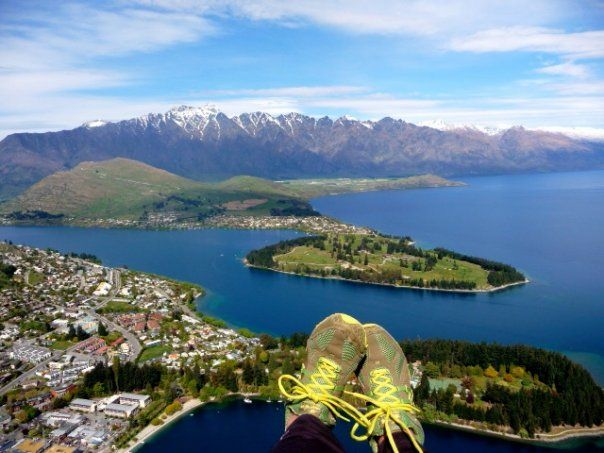 Paragliding over Queenstown N ZED.   those are my feet :)