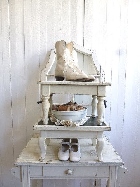 love the look of stacked stools with treasures dis[played