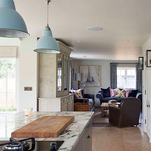 Enamel pendant lights by fritz fryer bring a splash of sophisticated colour to interior designer stephanie dunnings kitchen