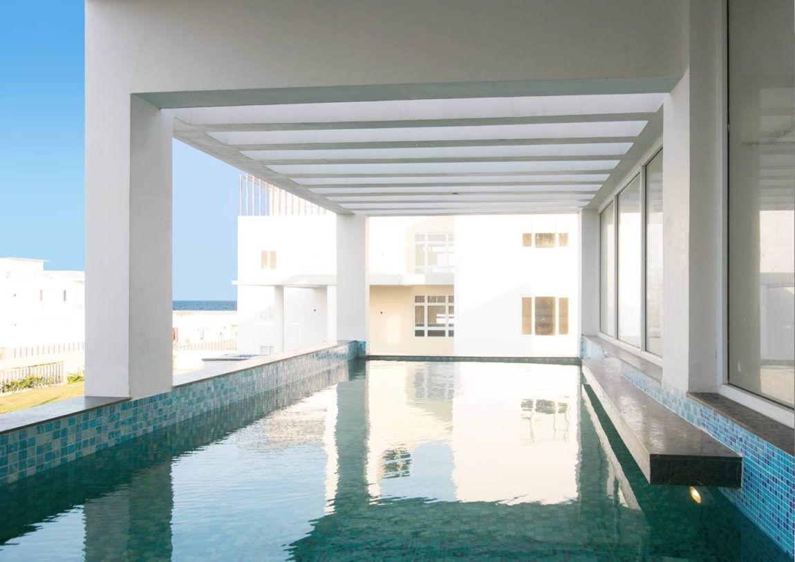 View of the pool backyard landscaping design chennai villa concrete also coastal located in india designed by inventarchitects rh pinterest