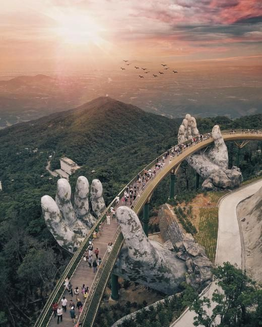 Pair Of Giant Cradling Hands Suspend A Golden Bridge In The Bà Nà Hills Near Da Nang, Vietnam #beautifulplaces