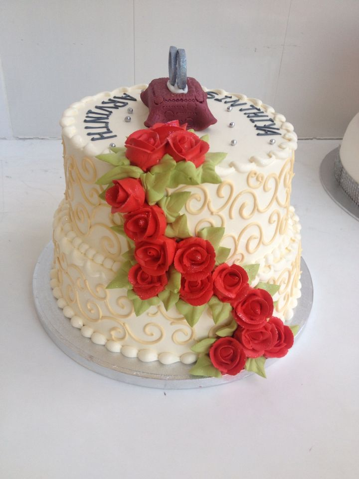 2 tier wedding cake with rings on top
