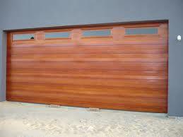 Timber Look Steel Colours The Teak Look With 4 Windows Wooden Garage Doors Garage Doors Teak
