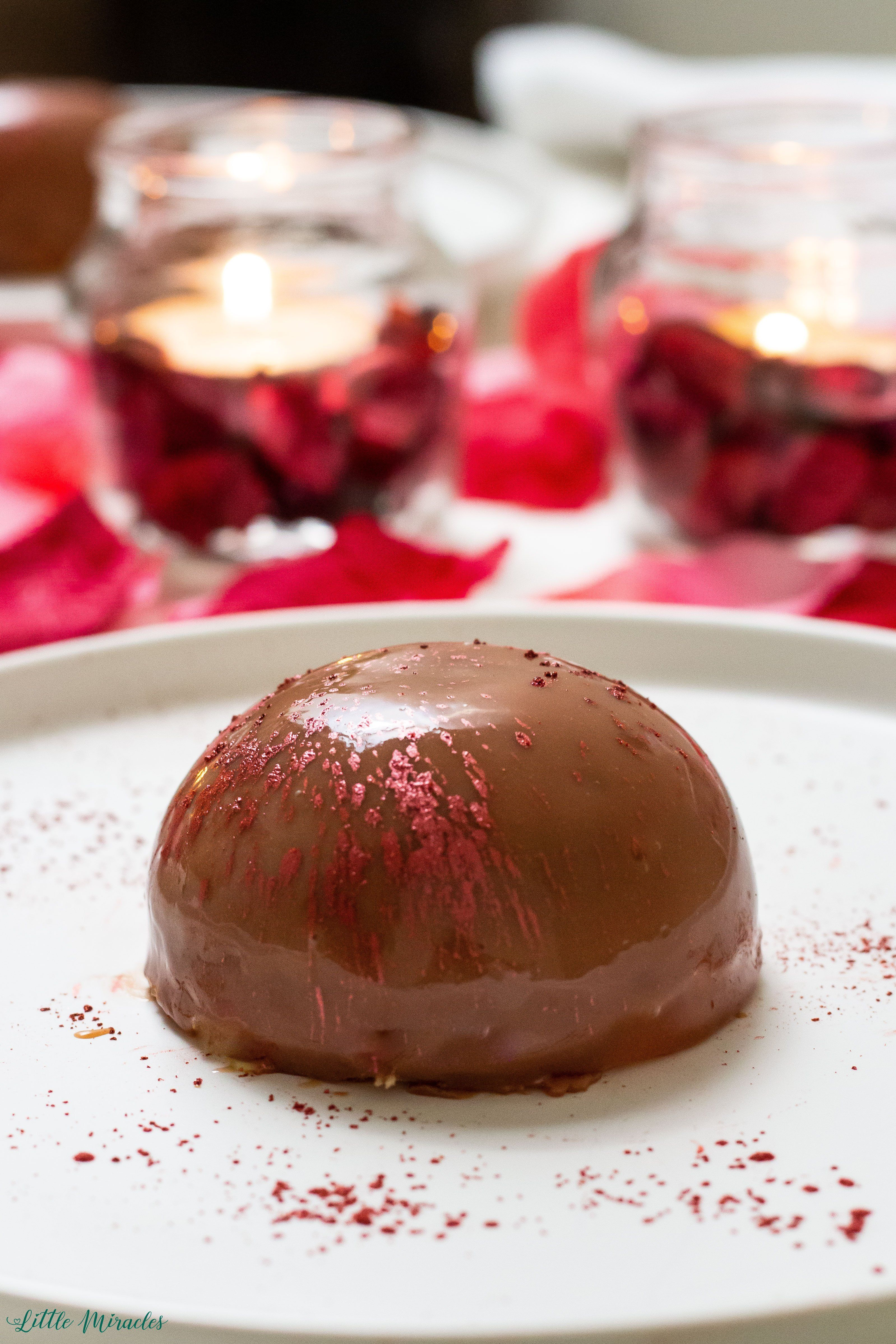 Chocolate Mousse with a Cherry Compote & Hazelnut Crumb Silky Chocolate Mousse stuffed with a tart Cherry Compote with a Hazelnut Crumb base and finished with a Milk Chocolate Mirror Glaze.