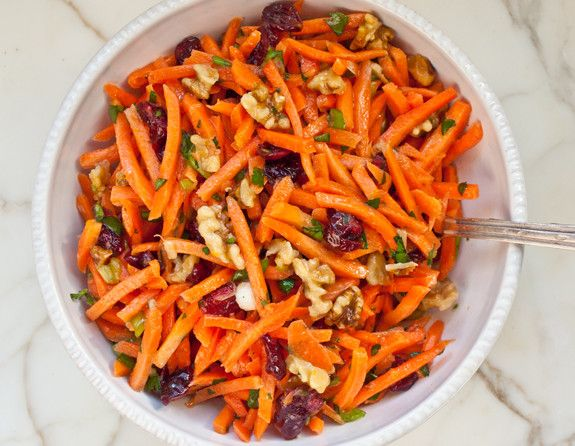 Tried this dressing with carrots, raisins, and toasted almonds instead. Excellent! Only need half the dressing though.
