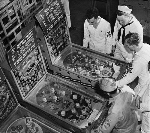Sailors playing pinball. Hawaii, 1942 ~