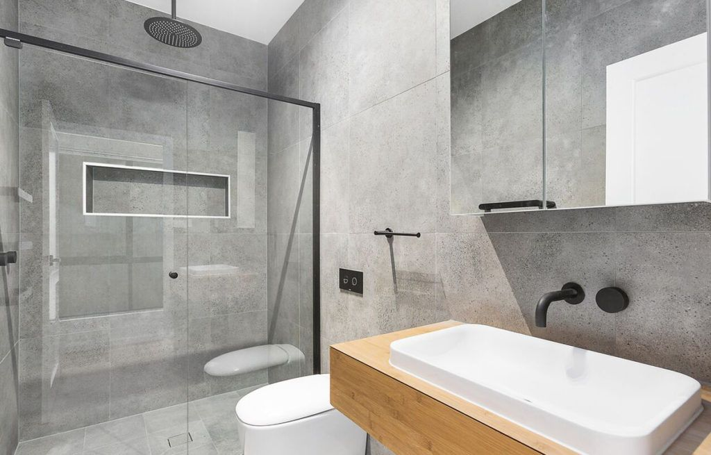 Get The Industrial Look With A Polished Concrete Tile Concrete Tiles Bathroom Concrete Bathroom Bathroom Wall Tile