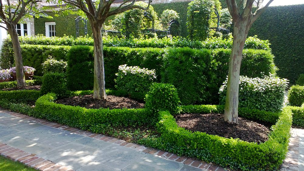 Path around the formal rose garden is made with cut slate flagstone ...