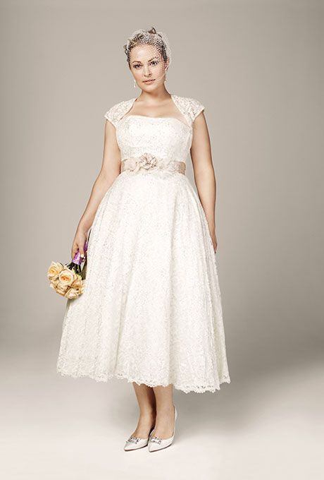 773fd94da821 Brides.com: 21 Stylish, Short Plus-Size Wedding Dresses Style 9T9948,  strapless tea-length gown with cap-sleeve shrug, $549, David's BridalPhoto:  Courtesy ...