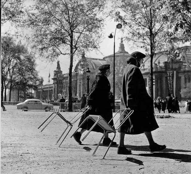 Robert Doisneau. this reminds me of the time there were no seats for us at the make and take in St. Mary's. and we had to lug our own chairs from table to table. here we are. this is us.