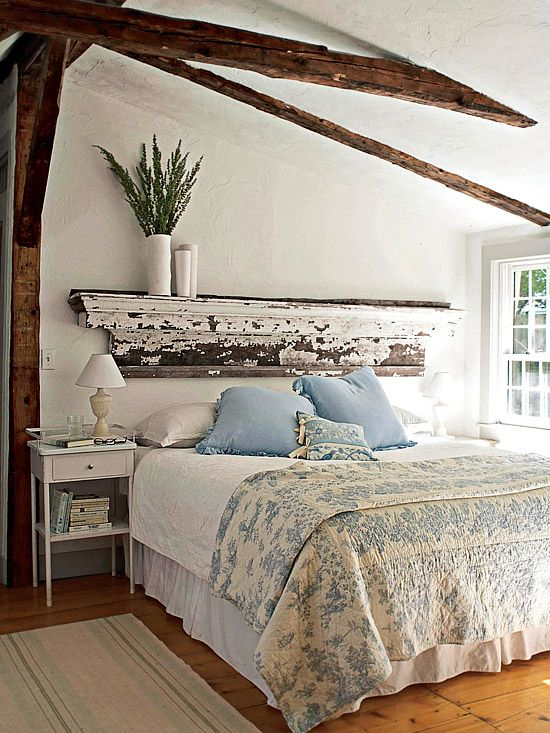 place of a headboard, a salvaged mantel gives this bedroom architectural flair. The more distressed the better for a vintage look like this