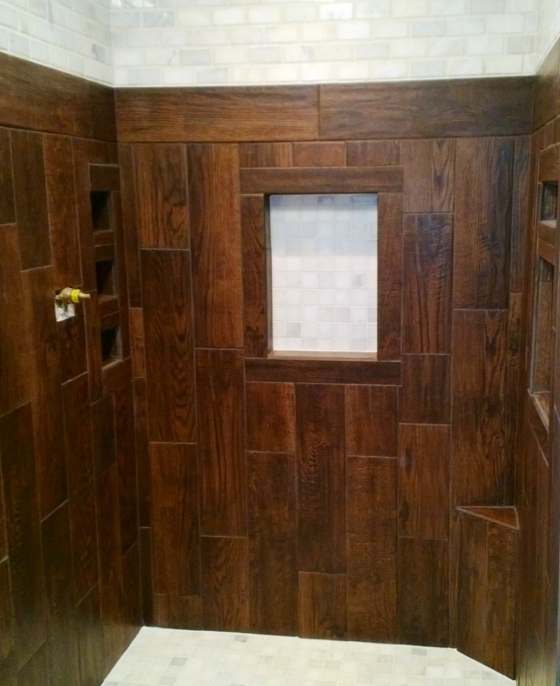 Shower stall. Ceramic tile that looks like wood. Also used subway ...