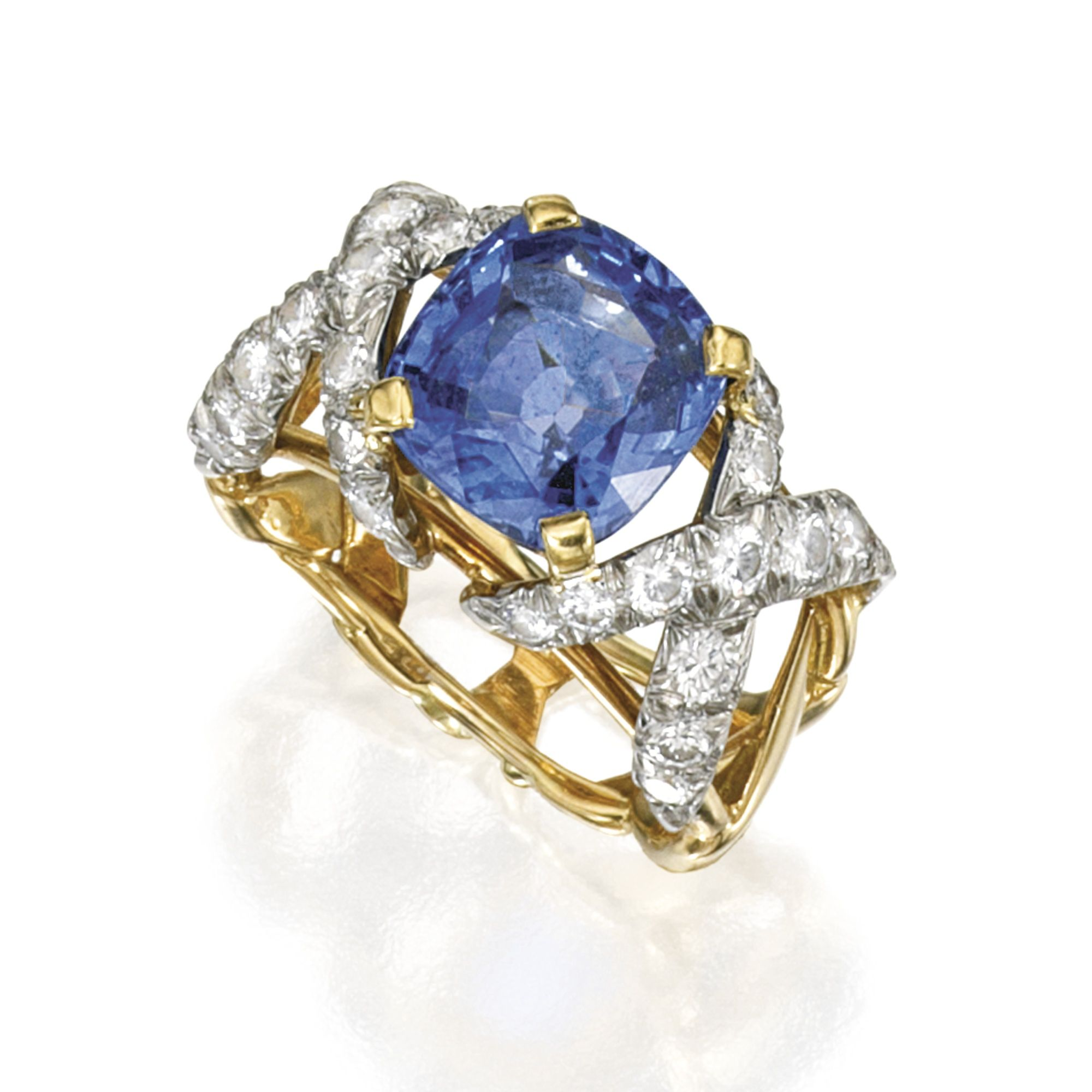 18 KARAT TWO COLOR GOLD SAPPHIRE AND DIAMOND RING MOUNTED BY