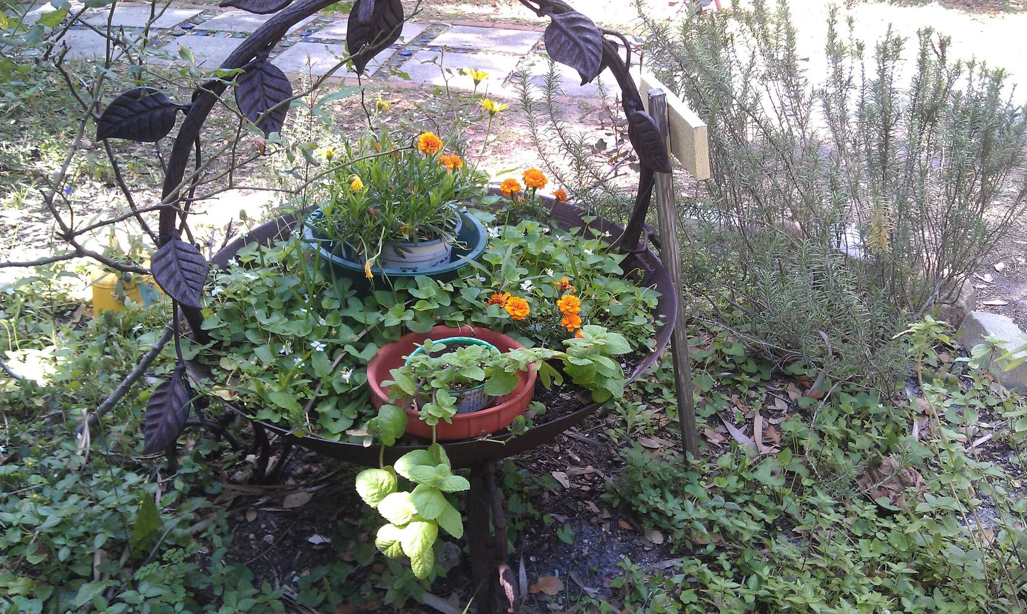 Dyi Recycled firepit w a planter Seen at the Children s