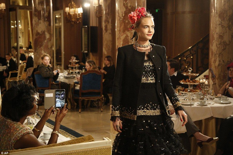 A sophisticated sightL Cara later changed into a black jacket embroidered with gold and won over a matching dress