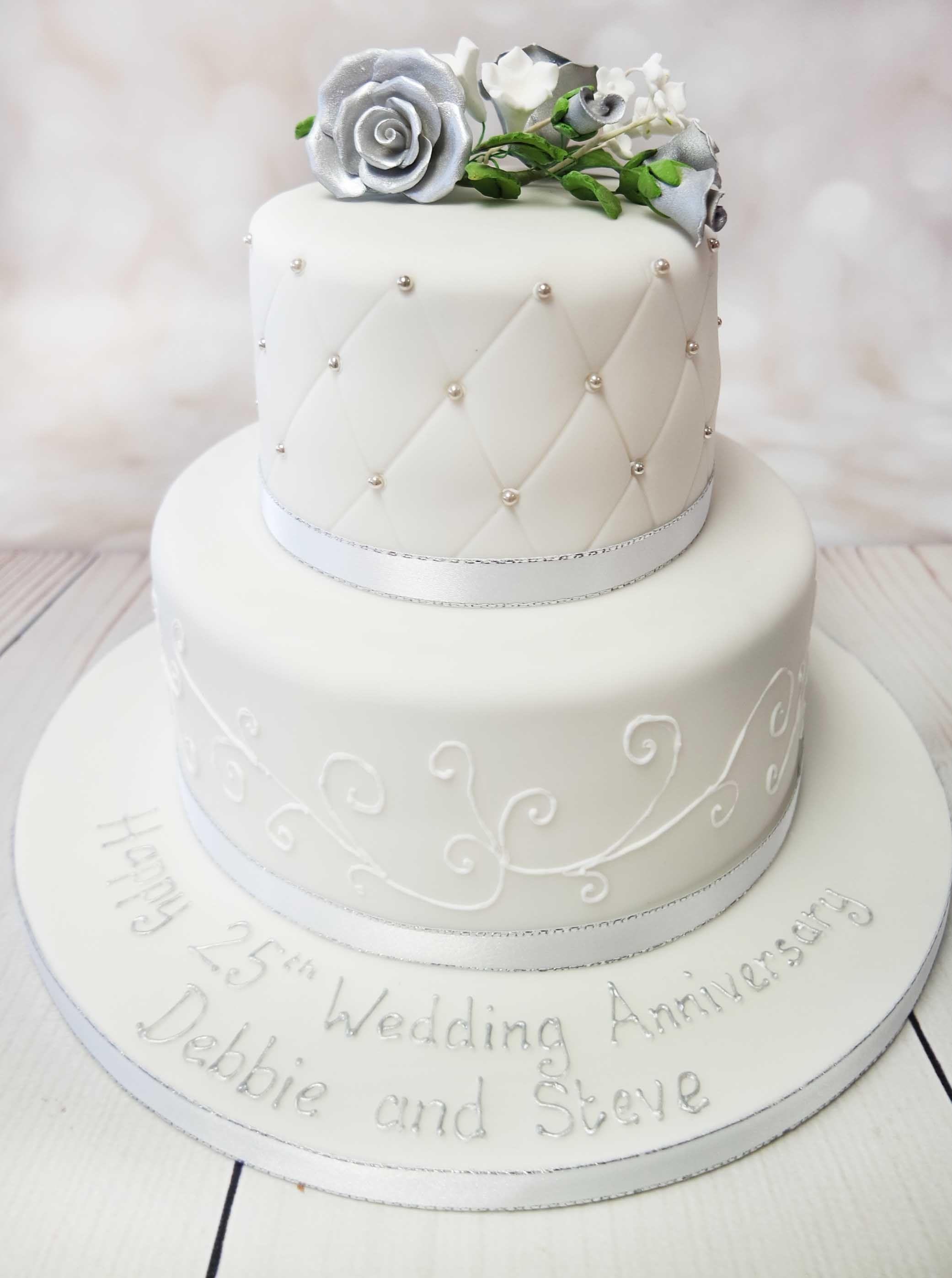 Elegant two tier wedding anniversary cake ...