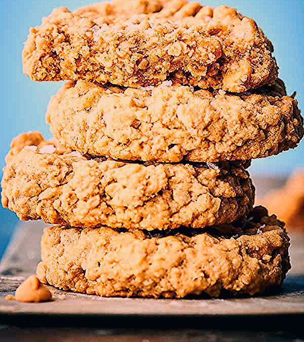 These peanut butter oatmeal cookies might just be the perfect cookie. Loaded with peanut butter, dark brown sugar, ground oats, whole oats, and peanut butter chips, these cookies are absolutely chewy and packed with peanut butter flavor! Gluten free. showmetheyummy.com #peanutbutter #oatmeal #cookies #glutenfree