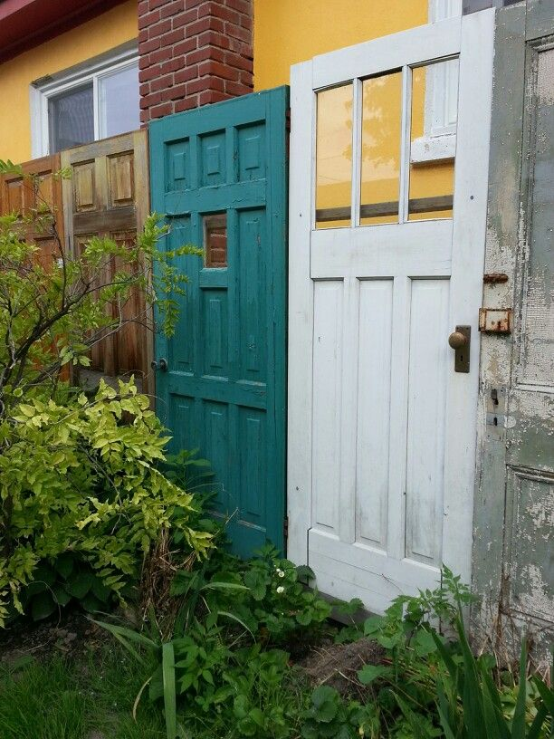 love this fence made out of old doors the purple cafe gananoque ontario - Purple Cafe Ideas