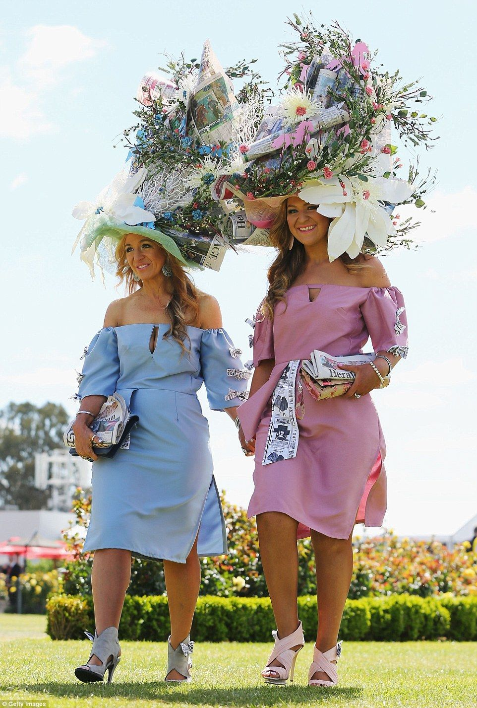 Looking sharp  Two early racegoers through the gates at Flemington on Crown  Oaks Day 2016 stunned in their overly elaborate headpieces (pictured) 7b71c74ee24