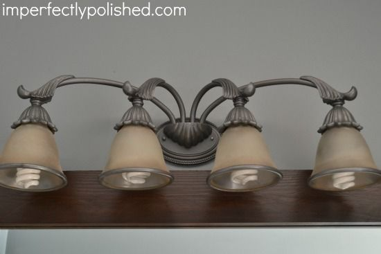 redoing bathroom light fixture. & Spray Painted Bathroom Light Fixture | Pinterest | Paint bathroom ...