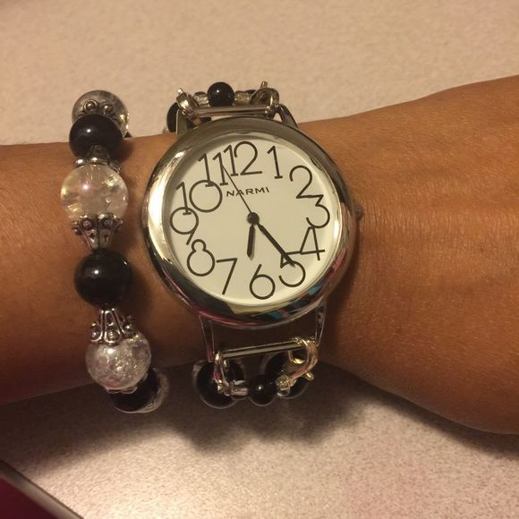 Black, silver and clear beaded watch/bracelet set Custom made Stretchy beaded watch and bracelet set. Watch face is white with black numbers. All silver hardware. Interchanges with other beaded watch bands or watch faces. Accessories Watches