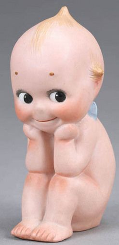 Germany, Kewpie doll. All bisque seated doll with molded hair and painted eyes, incised O'Neill on the bottom with a heart label on the back.