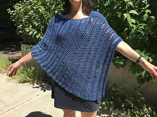 This is another variation on the 2-rectangle poncho. This is a super simple pattern that uses yarn-overs, then drops the stitches on the next row to create a vertical, wide, lace-like look. I alternated single- and double-yo's so that the stripes are wider then narrower. It turned out better than I expected!
