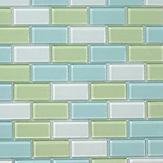 Glass subway tiles in muted sea glass colors of aqua and mint...love