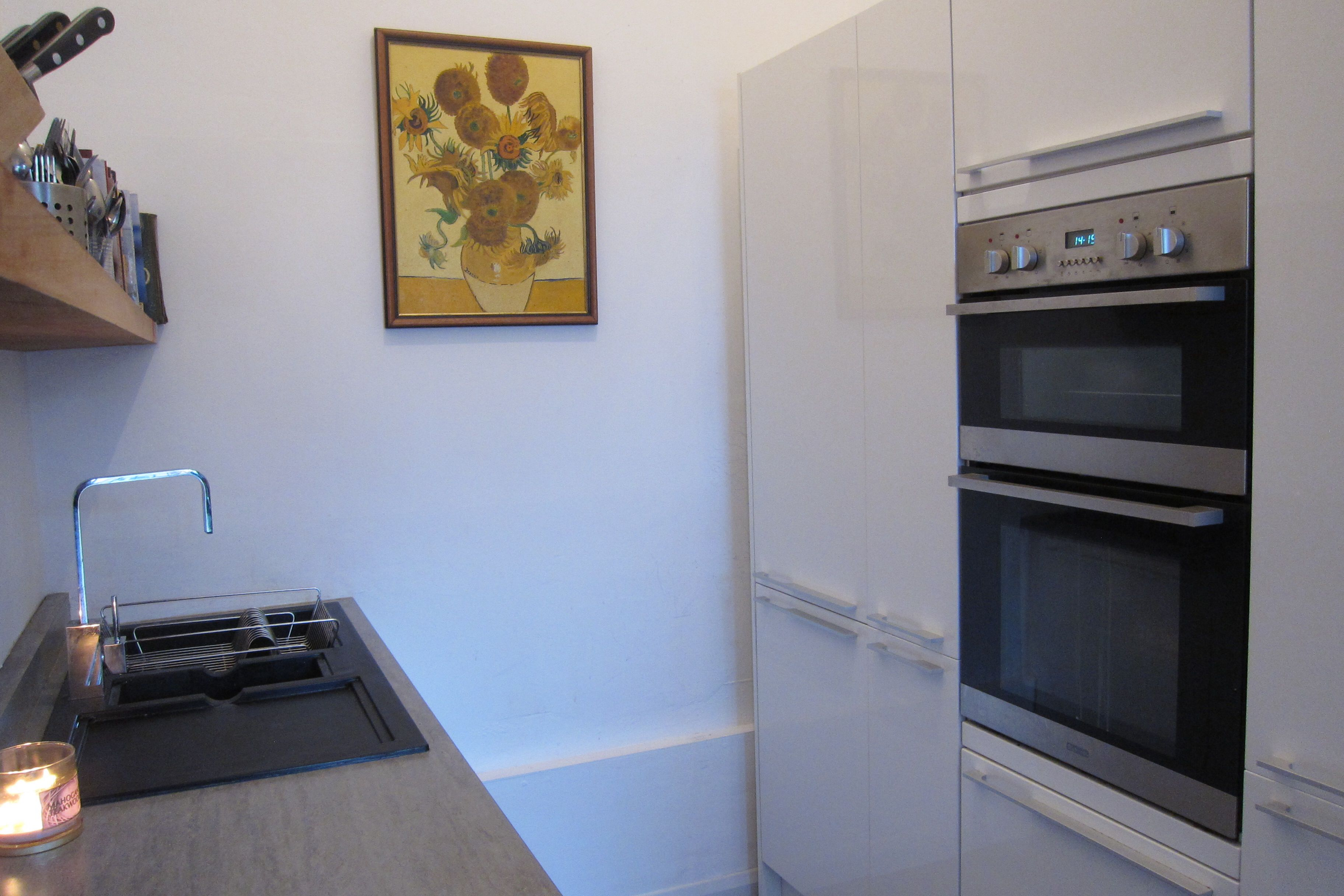 Small, white, modern, kitchen