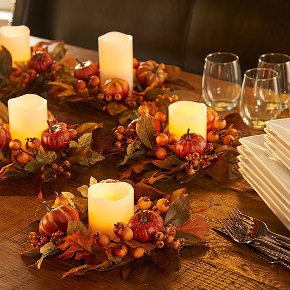 Multiple Fall Pumpkin Candle Rings Filled With Ivory Colored Flameless Candles Create A Beautiful Thanksgiving Table Decoration