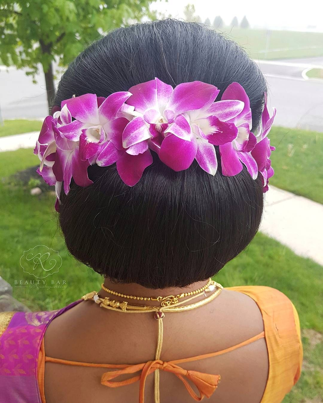 Beautiful Fresh Orchid Flowers On A Classic Low Bun Updo With Naturally Teased Hair On Top Love How It Turned Out Teased Hair Low Bun Updo Brunette Hair Color