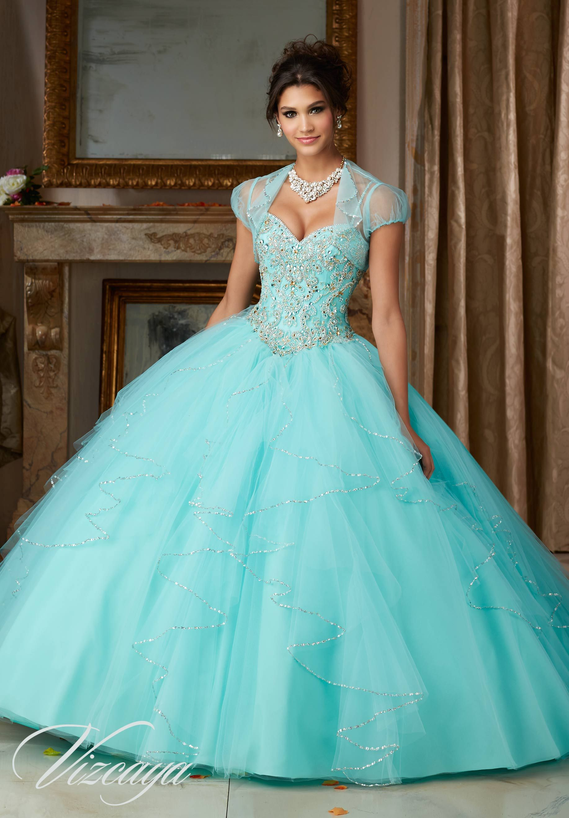 Jeweled beading on a flounced tulle quinceañera dress promhi