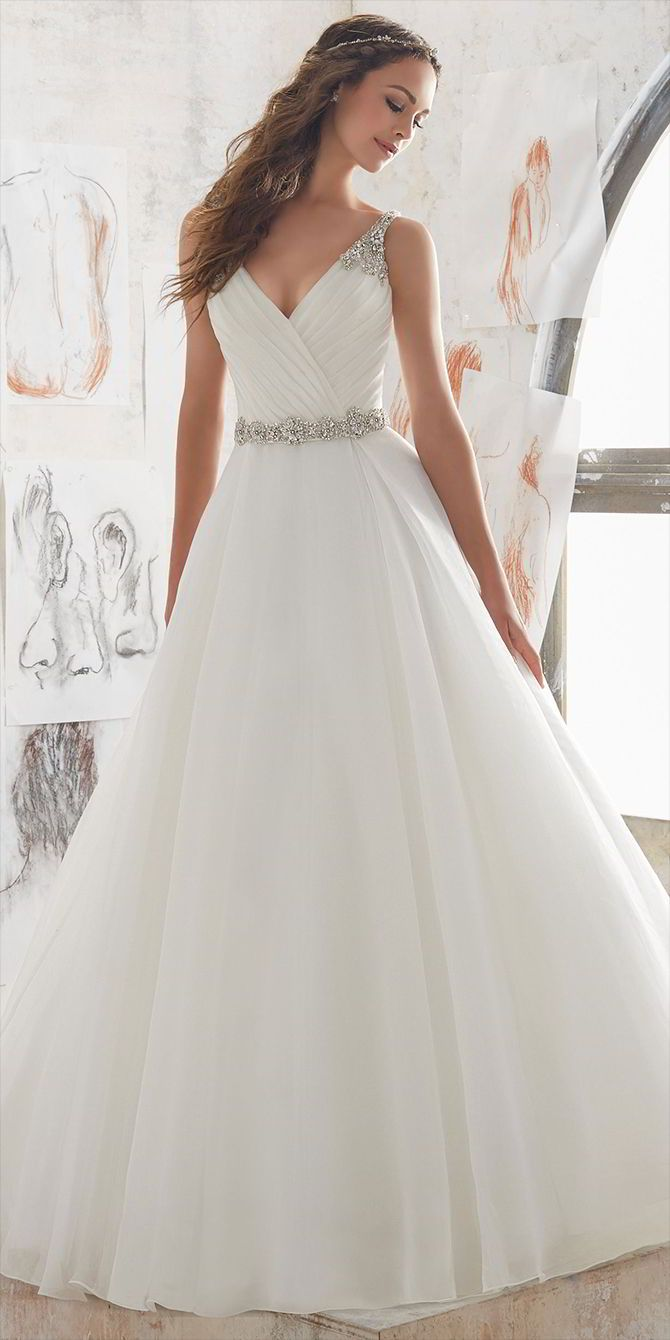 Airy and Light, This Organza Ballgown Combines a Traditional A- Line Silhouette with Modern Details. Diamant Beading Accents the Straps and Keyhole Back.