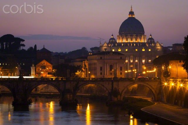 View from the river Tiber towards St. Peter's Basilica in Vatican City, Rome at dusk.