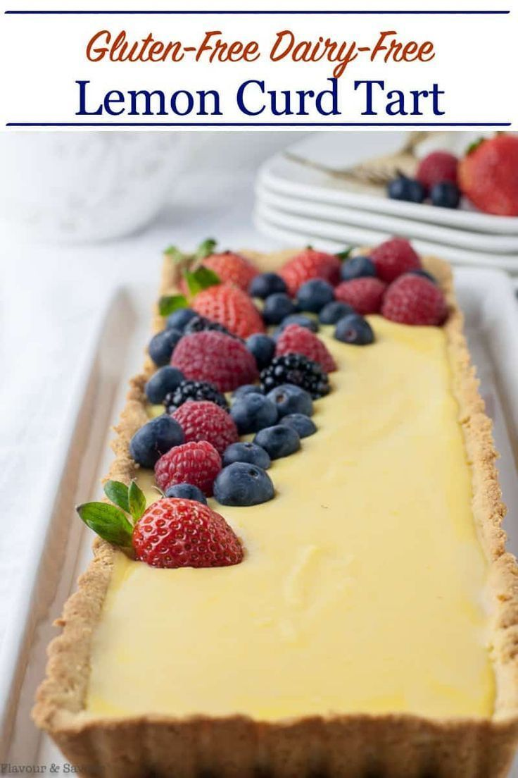 This luscious lemon curd tart is gluten-free, dairy-free, and refined sugar-free! It's made with a tender almond flour crust, garnished with fresh berries. #glutenfree #lemon_curd #pie #tart #glutenfreedessert #flavourandsavour
