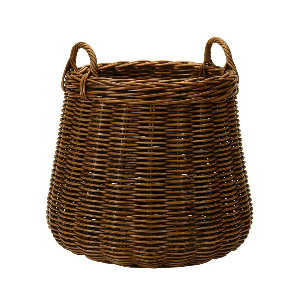 A Large Round Basket In Dark Rattan With An Antique Finish Rattan Basket Basket Design Wicker Baskets Storage
