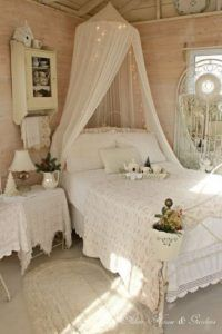 White Shabby Chic Bedroom With A Canopy Bed