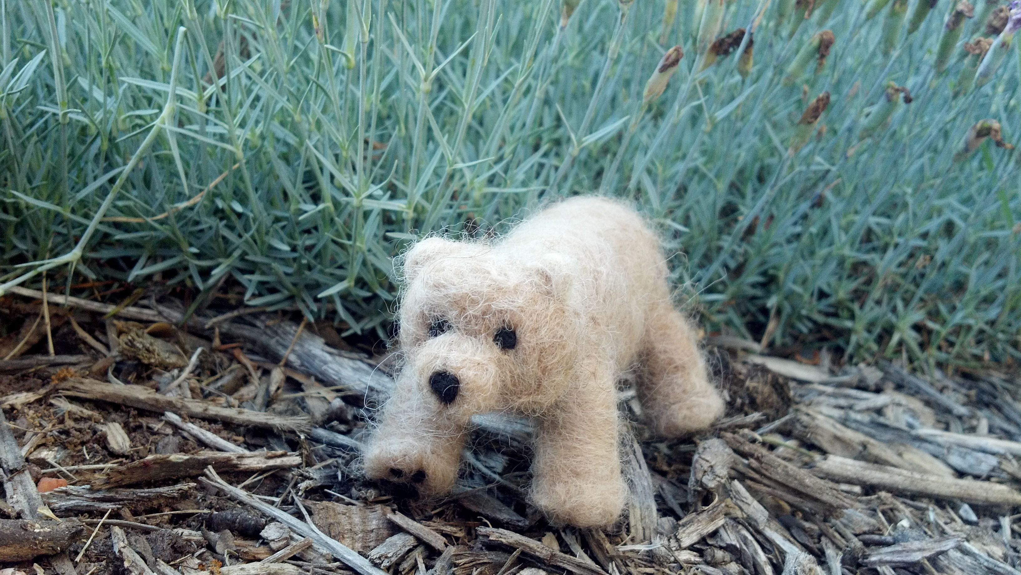 This is a handmade needle-felted bear made of 100% alpaca fiber!  Made by Ranch Acres Alpacas!