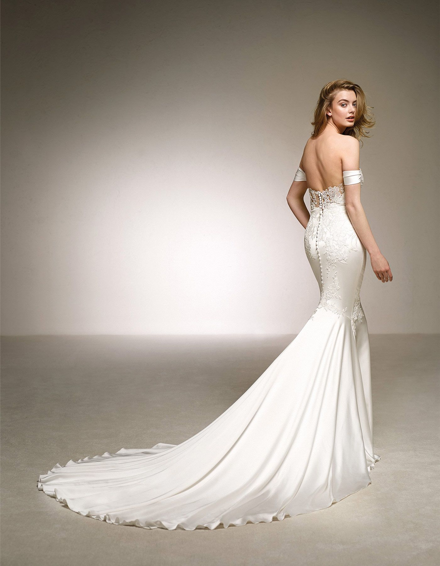 7a57432f6a49 Dante by Pronovias The silk satin glows with its own light in this  spectacular romantic design. A low waist wedding dress with a mermaid  skirt