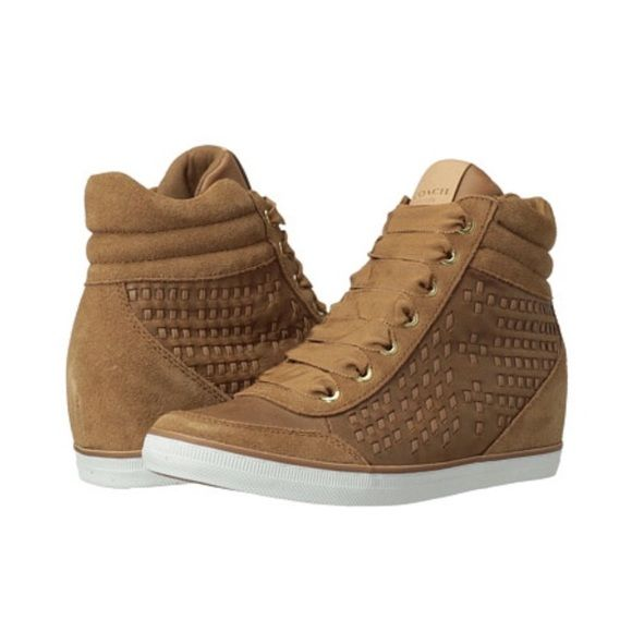 Coach Danae Wedge Sneaker Coach Danae Date  Worn once  2.5 inch wedge  No trades & Price firm!  Supple, hand-woven leather and plush suede transform a modern high-top with sophisticated texture and artisanal luxury. A hidden wedge gives it height and style, while grosgrain ribbon laces add a charming finishing touch. Coach Shoes Wedges