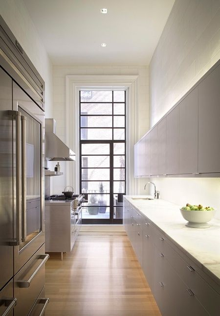 Another great example of casement windows-by extending the windows way above the door, this incredible kitchen is flooded with light.