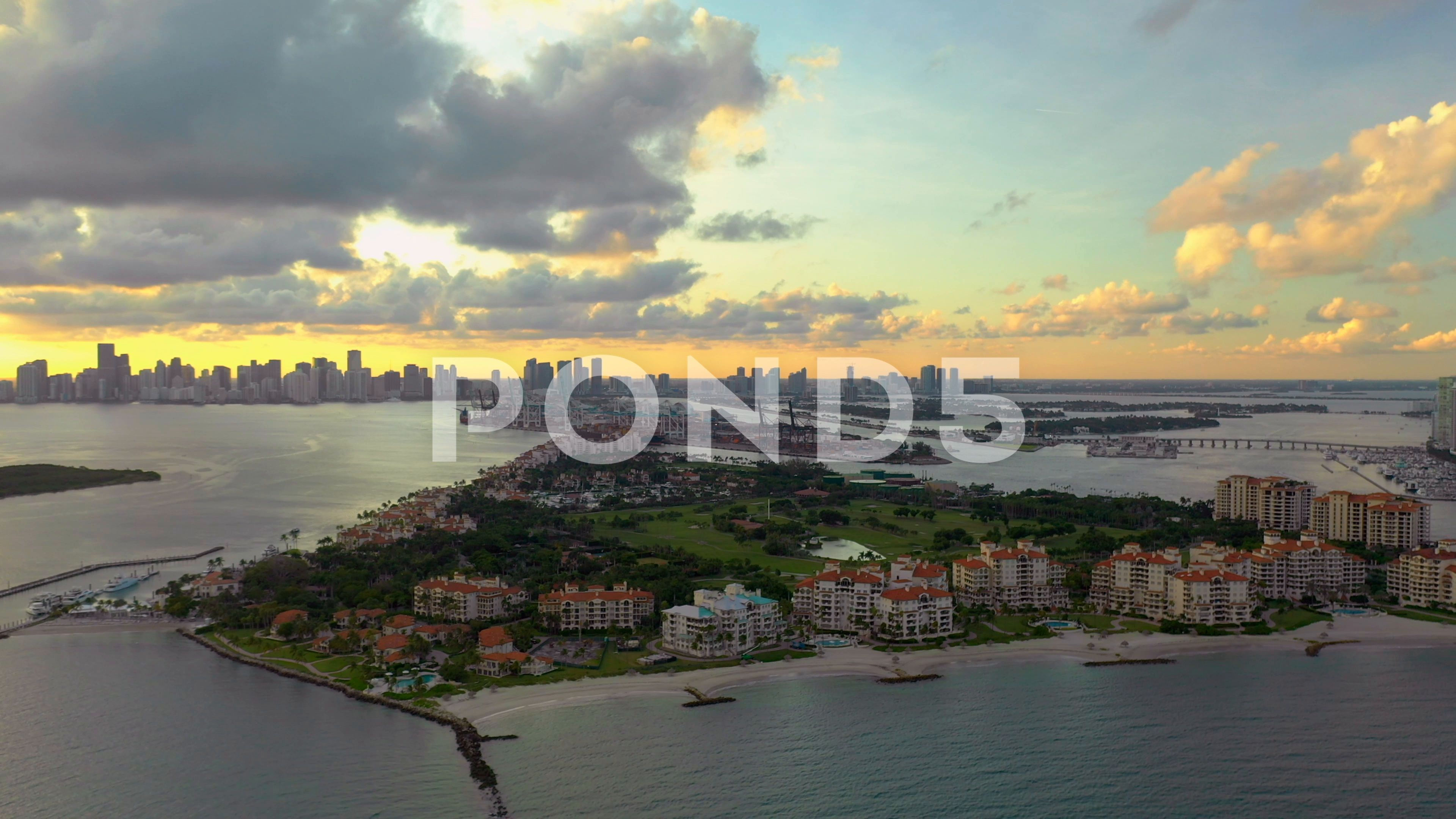 Pull out shot Miami Beach Fisher Island shot with a 4k drone Stock Footage MiamiBeachPullshot