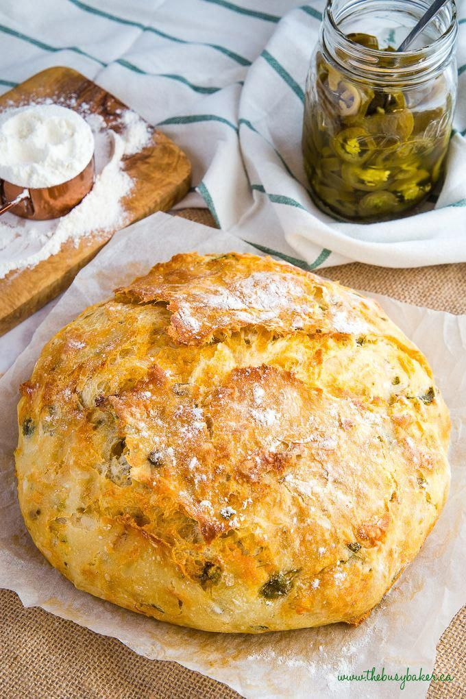This Easy No Knead Jalapeno Cheese Artisan Bread is the BEST savoury bread for sandwiches! It's packed with spicy pickled jalapeños and real cheddar cheese! Recipe from thebusybaker.ca! #cheese #jalapeno #bread #noknead #artisan #bakery #dutchoven #easyrecipe #recipe #comfortfood #jalapenorecipes